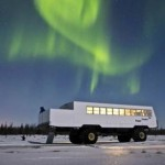 During Frontiers North Adventures' 'Northern Lights, Winter Nights' tour, the Tundra Buggy is converted into the Northern Lights Lounge with couches and wine and cheese service. Photo by Frontiers North Adventures